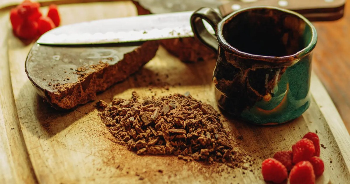 DoubleBlind: Image of ceremonial cacao on cutting board with mug. In this article, DoubleBlind explores the history of sacred cacao and its place in Western culture.