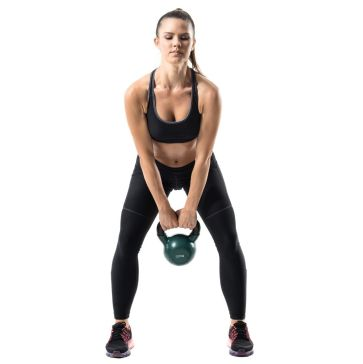woman doing kettlebell swings. One of the 5 full body exercises in this list.