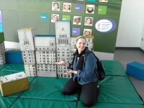 Fluffy thighs helping to proudly display my awesome building I made at the Museum of Liverpool