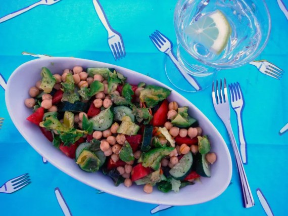 A delicious detox-approved green salad, with chick peas, avocado, cucumber, tomato and assorted butter lettuce.