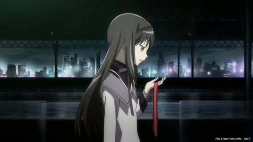 Homura Akemi holding Madoka Kaname's ribbons from the anime Puella Magi Madoka Magica