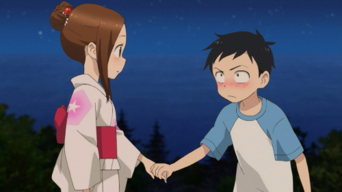 Takagi and Nishikata at a festival from the anime series Karaki Jouzu no Takagi-san 2