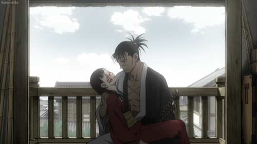 Manji holding an unconscious Rin from the anime series Blade of the Immortal