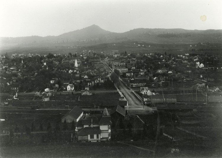 Black and white photograph taken of Eugene, Oregon in 1888. In the foreground is the Shelton-McMurphy House, with downtown Eugene stretching out into the background. The city is considerably smaller than it is today and has yet to have any of the recognizable landmarks of today's Eugene.