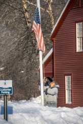 Raising the flag at the Historic Deerfield Post Office