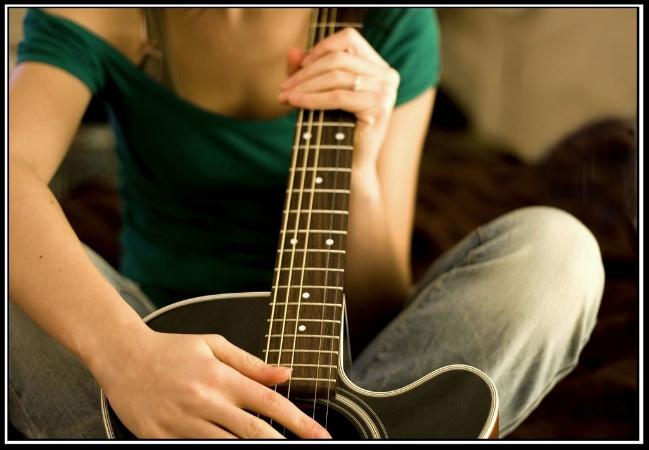 Sarah with guitar