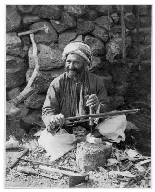 Man with a bow drill