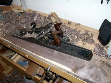 Squaring up rough-sawn walnut in preparation for resawing