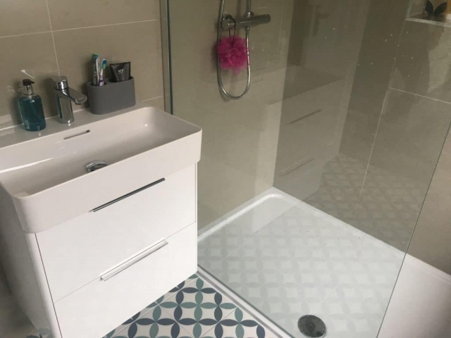 Shower room with geometric feature tile in Crossgates, Leeds.