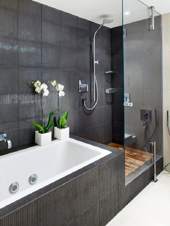 Large double ended built in bath with connected walk in style shower & concealed shower unit