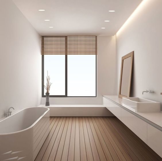 Bright,open bathroom with modern furniture and free standing bath