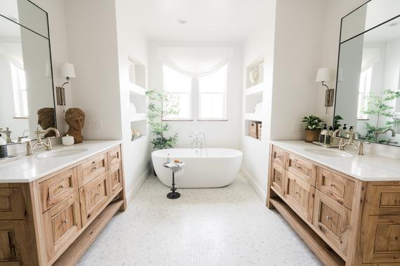 Large open t shaped bathroom with free standing bath