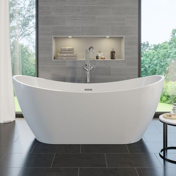 free standing bath with floor standing bath mixer with illuminated recess.