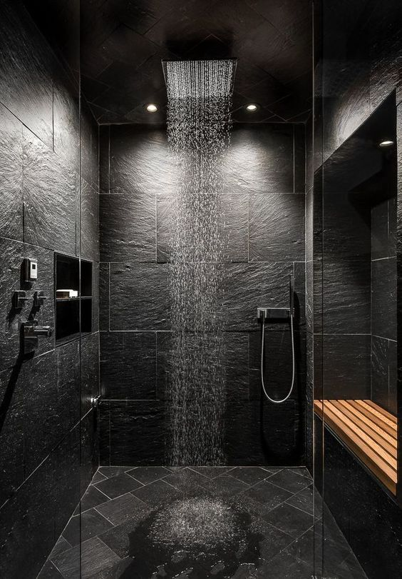 open wet room shower with slate effect tiles and recessed bench