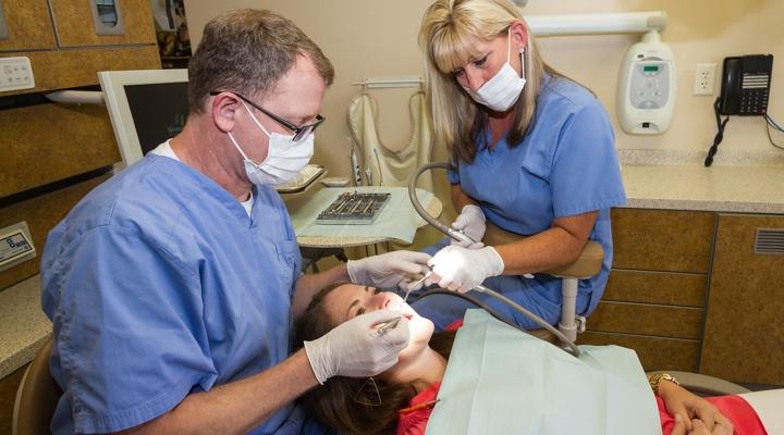 doug lewis dmd performing teeth restoration
