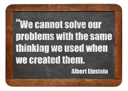 24978696 - we cannot solve our problems with the same thinking we used when we created them - a quote from albert einstein - white chalk text on a vintage slate blackboard