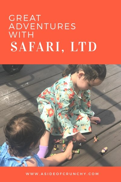 girls sitting and playing with Safari toys