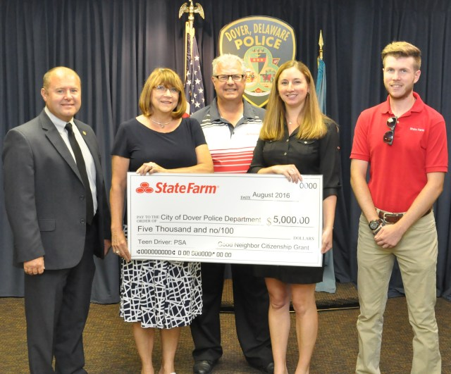 Local State Farm agents present a check to chief Paul M. Bernat. Left to Right: Chief Paul M. Bernat, Kathy Safford, Tom Deladvitch, Katie Bennett, and Tom Deladvitch