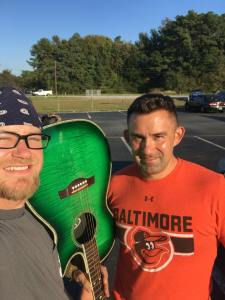 Detective Knight (right) meets with Dave Nickolson to return his guitar while off-duty.