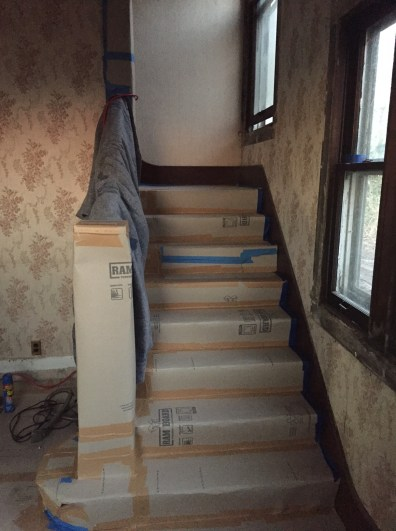These are some protected stairs! The rest of the house has the same stuff on it...with far less tape.