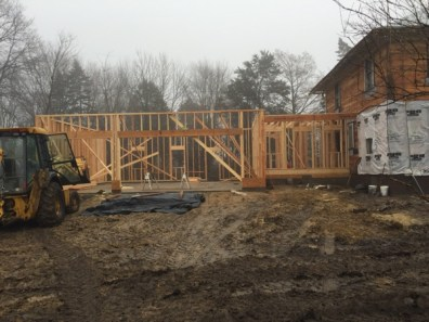 And just a day later, walls up for the garage!