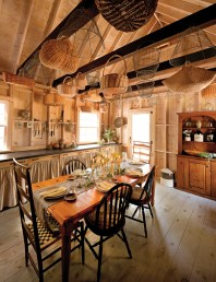 rustic dining room with wicker baskets hanging from ceiling