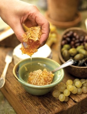 honeycomb in bowl filled with honey