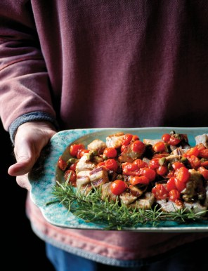 plate of cooked meat and tomatoes with rosemary