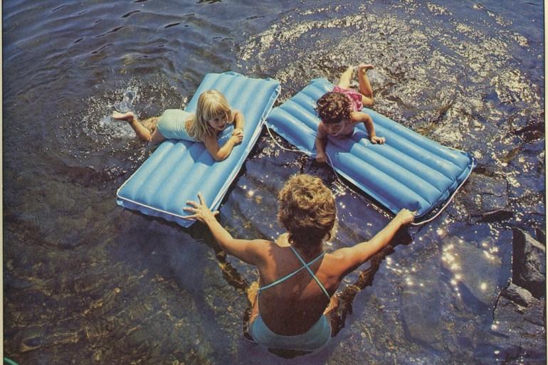 Woman swimming with children Damariscotta Lake 1984