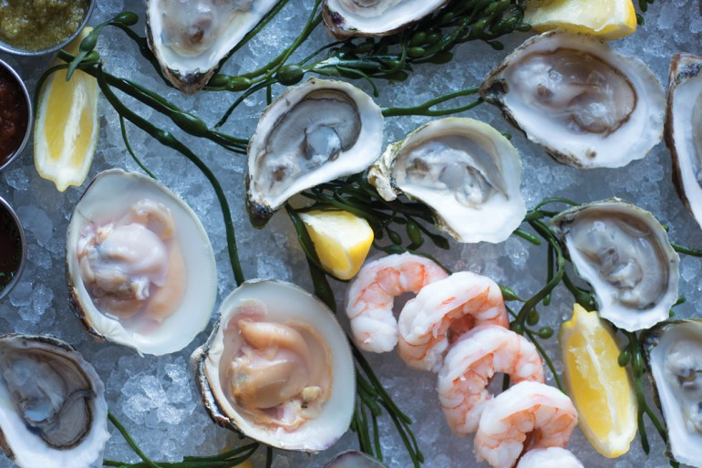 Oysters, shrimp, and clams from the 18 Central raw bar.