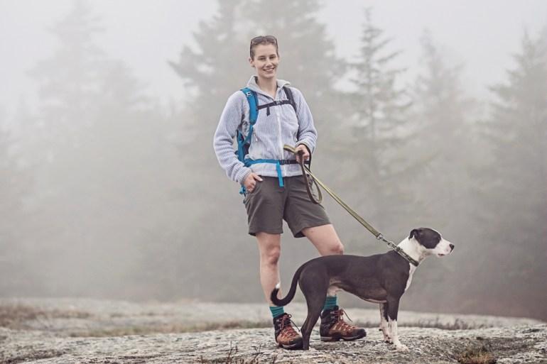 woman walking dog on Great Pond Mountain