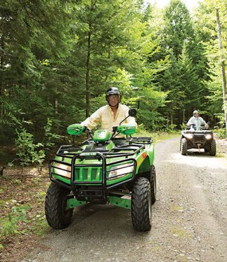 Al and Sue LaPlante, of Chet's Camps, on ATVs.