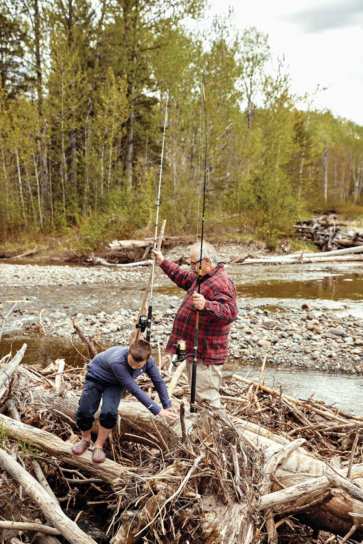 Bubier and his grandson, Eben, fish in Wildcat Brook at the northern edge of the North Maine Woods.