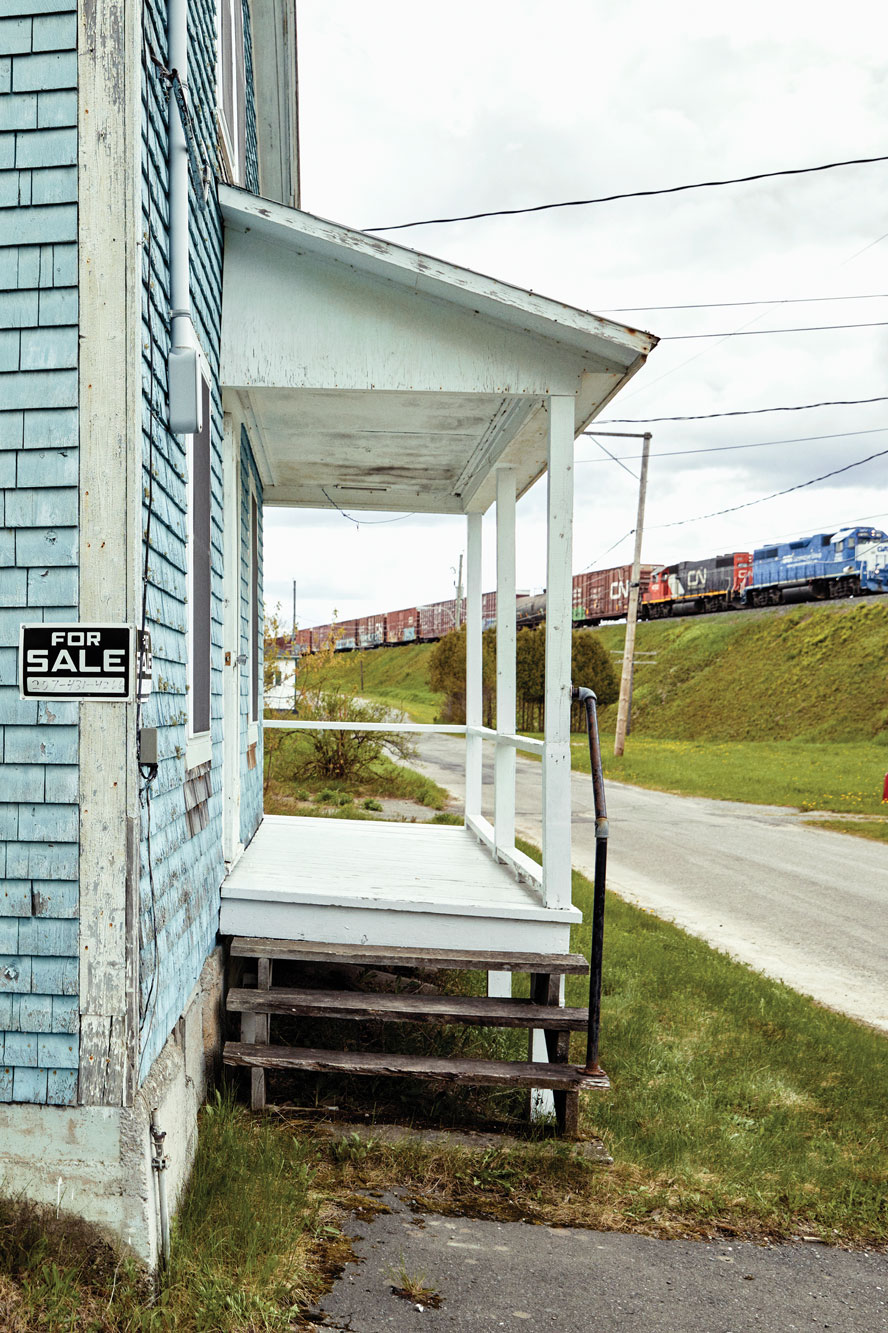 A Canadian National Railway train passes atop the berm in front of Scot Bubier's camp, the northernmost house east of the Mississippi.