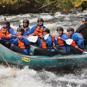 GSA outdoor leadership class rafting on the Kennebec River.