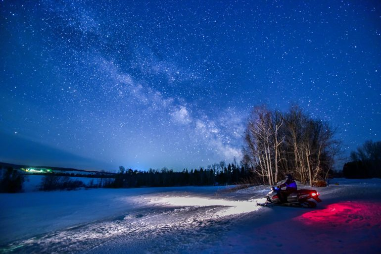 snowmobiling Aroostook County at night