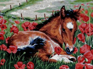 Cross stitch pattern with download instantly in PDF file, to embroider a foal lying among poppies