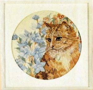 Cross stitch pattern with FREE download instantly in PDF file, to embroider a cat with flowers