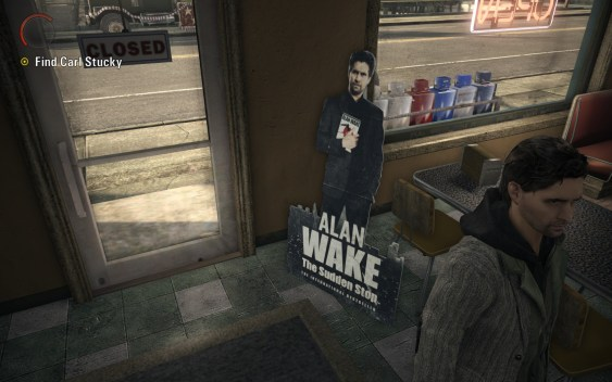 Alan Wake In Front Of Life-Size Standup Poster