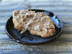 Picture of cream cheese chicken gravy on a biscuit
