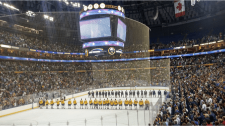 Sabres prospects await play during the anthems in front of nearly 17,000 fans.