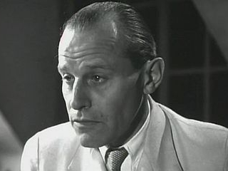 Actor Geoffrey Wincott in the 1948 film Dick Barton, Special Agent, playing a villain