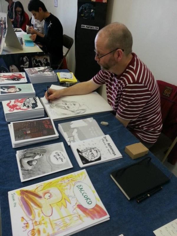 Sean Azzopardi sketching at the event. Photo courtesy Malta Comic Con