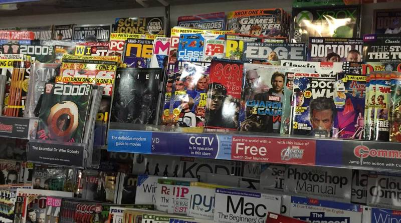 """These snapshots of the """"teen"""" comics section of WHSmith Lancaster in 2017 indicate just how many comics are vying for space, and the different ways they are promoted with """"pop out"""" bins and shelving stickers. Which seem to have worked for Commando, which has apparently sold out!"""