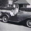 Bob Batholomew, circa 1949, in his red Singer Le Mans sports car. Photo via Bear Alley.