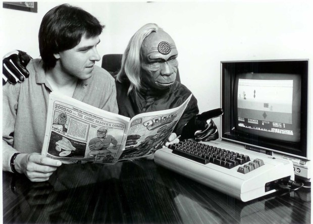 Tharg during his first few years on Earth, explaining to a magazine editor that computers work better worn on your wrist.