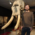 Comic artist Oliver East - and friend at Manchester Museum. Image courtesy Manchester Museum
