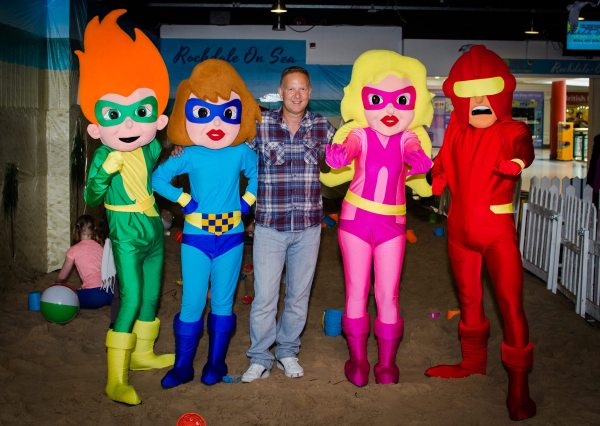 Comics creator and Funny Monsters Comic publisher Joe Matthews and the All Star Squad, characters he created for Rochdale's Wheatsheaf Shopping Centre kids club. Photo via Joe Matthews.