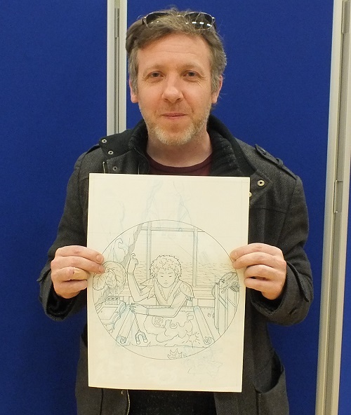 Stephen White (Stref) shows off the pencils for his new Peter Pan graphic novel at Wonderlands 2015. Photo: Jeremy Briggs