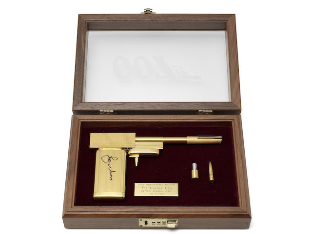 A replica gun from The Man with the Golden Gun, signed by Roger Moore.